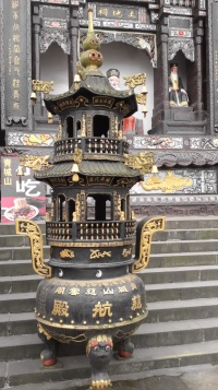 Incense Stick burner in front of the palace