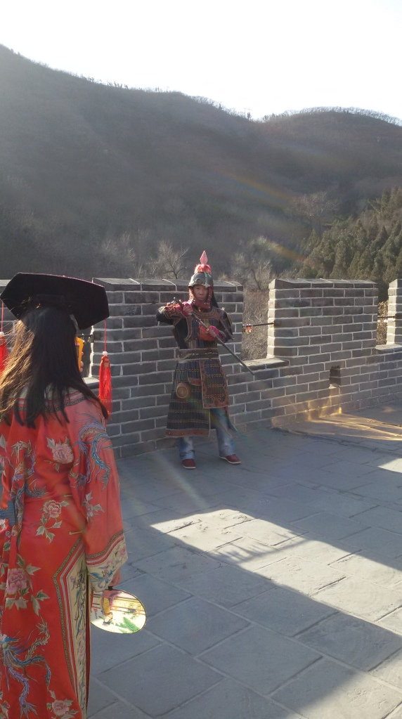 A tourist dressing up as a soldier at the Great Wall