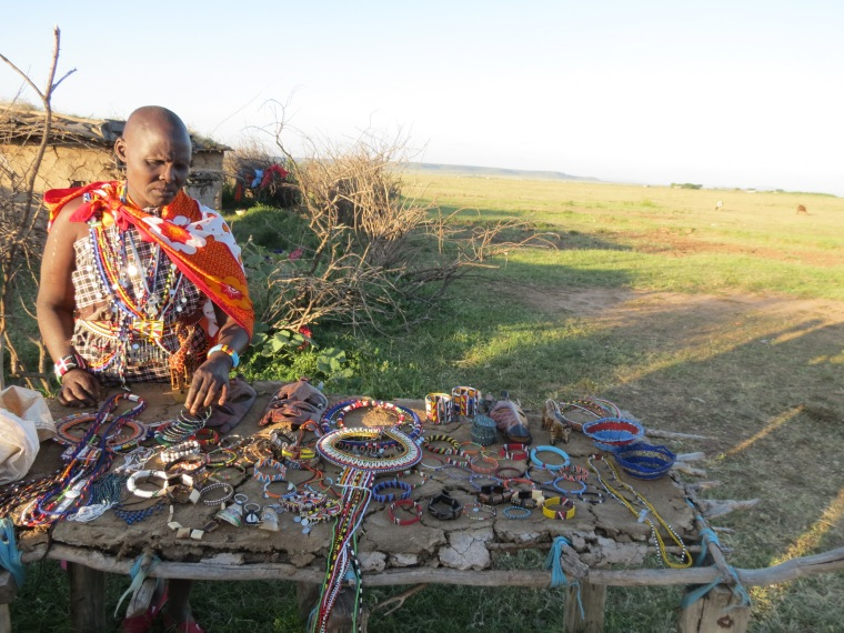 A woman selling their handiwork in the village