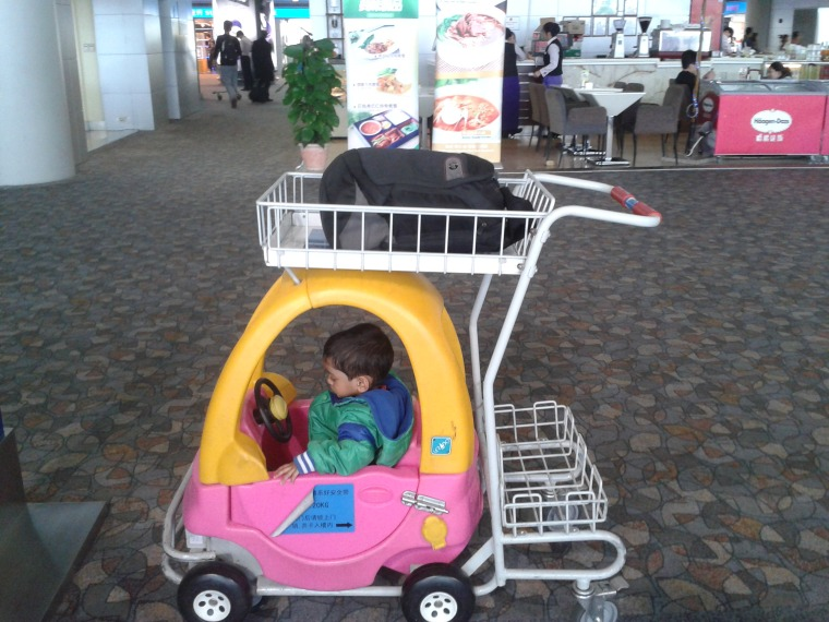 At an airport in China when traveling alone with my kid